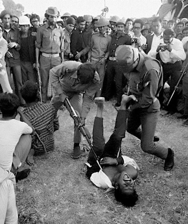 JeI paramilitary, along with Pakistani regulars, torturing and murdering Bangladeshi civilians
