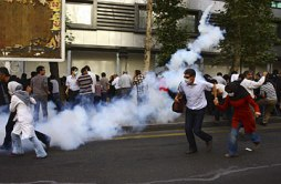 Pro-democracy Iranian demonstrators are tear-gassed by IRGC.