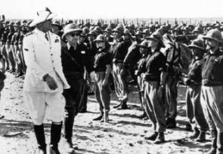 Italian Marshal Rodolfo Graziani reviews a Fascist Black Shirt unit during the Italo-Ethiopian War of 1935. Courtesy Times of Malta.