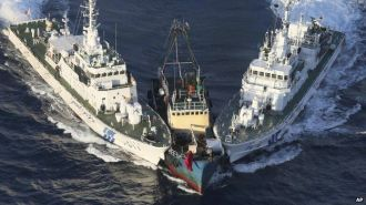 Japanese Coast Guard vessels intercept a Chinese fishing boat near the disputed Senkaku Islands.