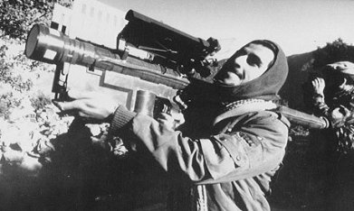 U.S. supplied Stinger Missile launcher in the hands of a Mujahideen fighter. They needed these to destroy the armored Soviet Hind attack helicopters.