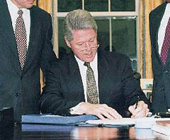 Clinton Signs Iraq Liberation Act of 1998