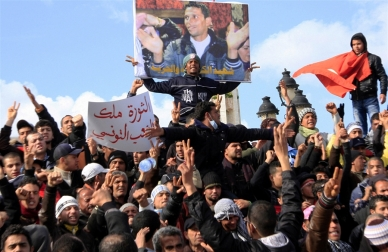 Region-wide mass protests against Arab strongmen began following the self-immolation of Tunisian street vendor, Mohamed Bouazizi.