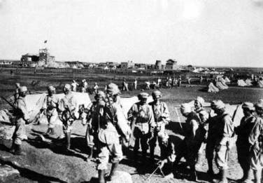 The French marching on the Syrian coast proclaiming the French-Syrian Mandate, 1920.