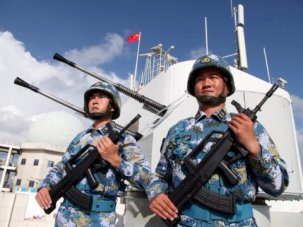 Chinese People's Liberation Army Navy officers stand on guard