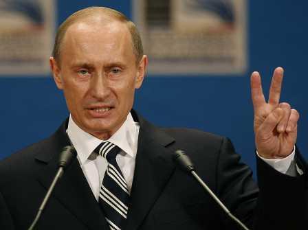 Russian President Vladimir Putin expressing an ambivalent peace sign.