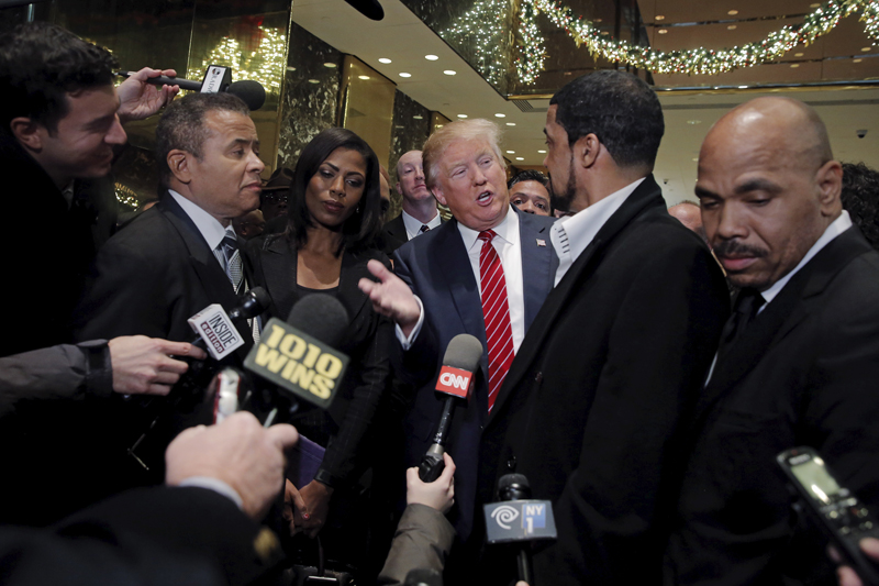 Presidential candidate Donald Trump speaks to the media after meeting with a group of black pastors at his office in the Manhattan borough of New York