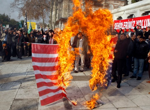 Protesters shout slogans as they burn a U.S. flag during an anti-America protest after Friday prayers in Istanbul December 2, 2011. Courtesy of REUTERS/Osman Orsal