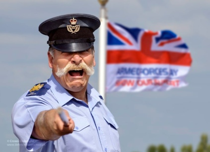 RAF Warrant Officer with the Armed Forces Day Flag