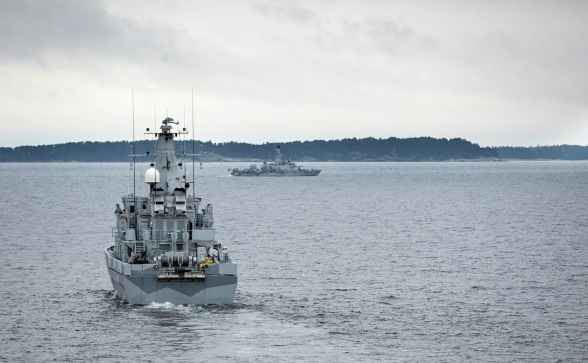 Swedish warships conducting anti-submarine operations in Swedish territorial waters in pursuit of Russian subs, 2014.